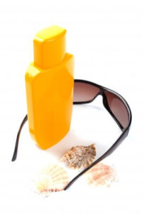 sun lotion and glasses